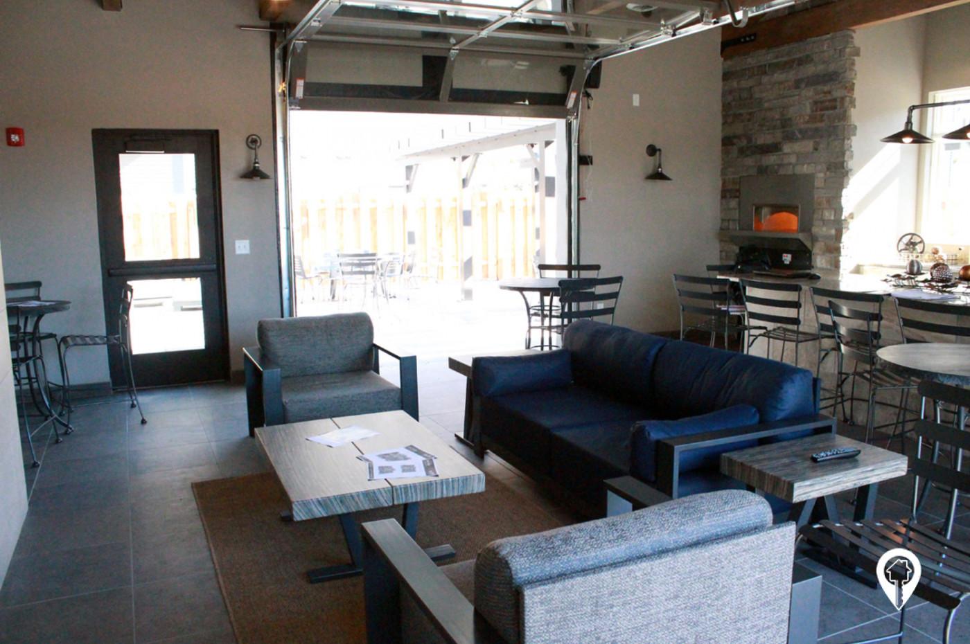 Deer-Ridge-Apartments-Unique-indoor-outdoor-kitchen-entertaining-space